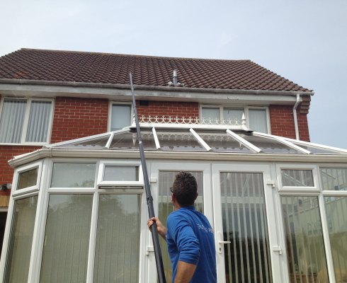 Gutter cleaning Norwich - house with conservatory